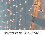christmas lights burning on a... | Shutterstock . vector #516322393