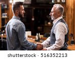 barber and client shaking hands | Shutterstock . vector #516352213