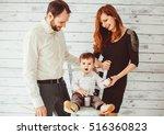 happy parents standing near... | Shutterstock . vector #516360823