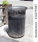 black public trash can on city... | Shutterstock . vector #516379387