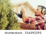 hedge trimming works in a... | Shutterstock . vector #516392293