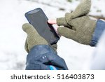 male hands in gloves using a... | Shutterstock . vector #516403873
