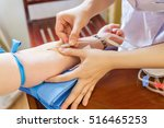 taking a blood sample | Shutterstock . vector #516465253