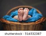 legs of a newborn in a basket.... | Shutterstock . vector #516532387