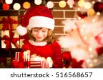 Child Holding Christmas Gift....