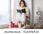 Woman Reading Book In Christma...
