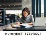 female student taking notes... | Shutterstock . vector #516640027