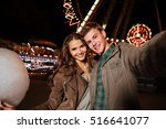 smiling beautiful young couple... | Shutterstock . vector #516641077