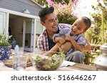 father and son eating outdoor... | Shutterstock . vector #516646267