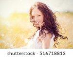 beauty girl outdoors enjoying... | Shutterstock . vector #516718813