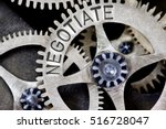Small photo of Macro photo of tooth wheel mechanism with NEGOTIATE concept letters