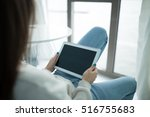 using a tablet pc touchpad in a ... | Shutterstock . vector #516755683