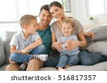 happy family of four sitting on ... | Shutterstock . vector #516817357