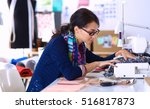 young woman sewing while... | Shutterstock . vector #516817873