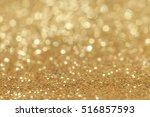 abstract golden glitter light... | Shutterstock . vector #516857593