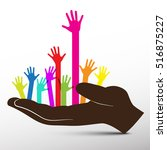 colorful hands in big hand... | Shutterstock .eps vector #516875227