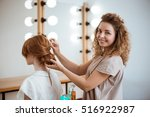 female hairdresser smiling... | Shutterstock . vector #516922987