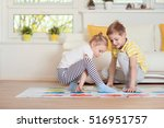 two happy children playing... | Shutterstock . vector #516951757
