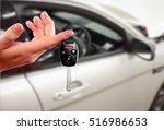dealer hand with a car key. | Shutterstock . vector #516986653