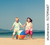 Small photo of Child Sibling Ball Beach Carefree Summer Concept