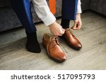 the man wears shoes. tie the... | Shutterstock . vector #517095793