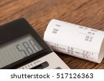 receipts with calculator | Shutterstock . vector #517126363
