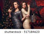 two blonde and dark hair girls... | Shutterstock . vector #517184623