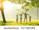 asian family walking outdoor in ... | Shutterstock . vector #517185283