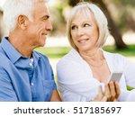 happy senior couple looking at... | Shutterstock . vector #517185697