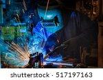 worker is welding automotive... | Shutterstock . vector #517197163