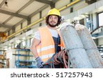 young manual worker moving gas... | Shutterstock . vector #517257943