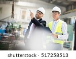 mid adult male supervisors... | Shutterstock . vector #517258513