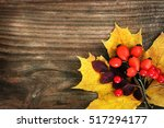 autumn leaves on wooden... | Shutterstock . vector #517294177