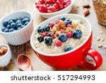 oatmeal porridge with fresh... | Shutterstock . vector #517294993