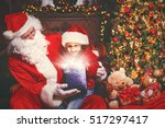 Santa Claus And Child Girl Wit...