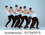 Small photo of Group of men and women dancing hip hop choreography