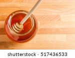 honey with dipper on wooden... | Shutterstock . vector #517436533