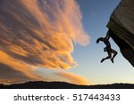 female climber dangles from the ... | Shutterstock . vector #517443433