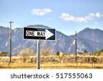 one way road sign with blurred