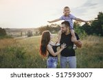 young family with a child have... | Shutterstock . vector #517593007
