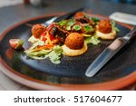 delicious falafel dish with... | Shutterstock . vector #517604677