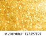 abstract bokeh of golden... | Shutterstock . vector #517697503