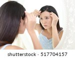 woman look unhappy with her hair | Shutterstock . vector #517704157