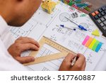 architect drawing blueprint | Shutterstock . vector #517760887