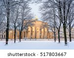 Stock photo trees of berlin tiergarten and illuminated brandenburg gate brandenburger tor in snow berlin 517803667