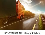 truck rolls through a sunny... | Shutterstock . vector #517914373