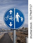 Walking And Bike Road Sign On...