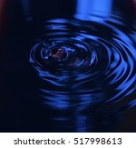 Dark Blue Water Drop Into Wate...