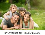 happy family in a park  two... | Shutterstock . vector #518016103