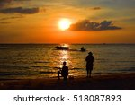 fisherman and sunset on the... | Shutterstock . vector #518087893
